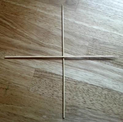 Two kebab skewers forming a cross