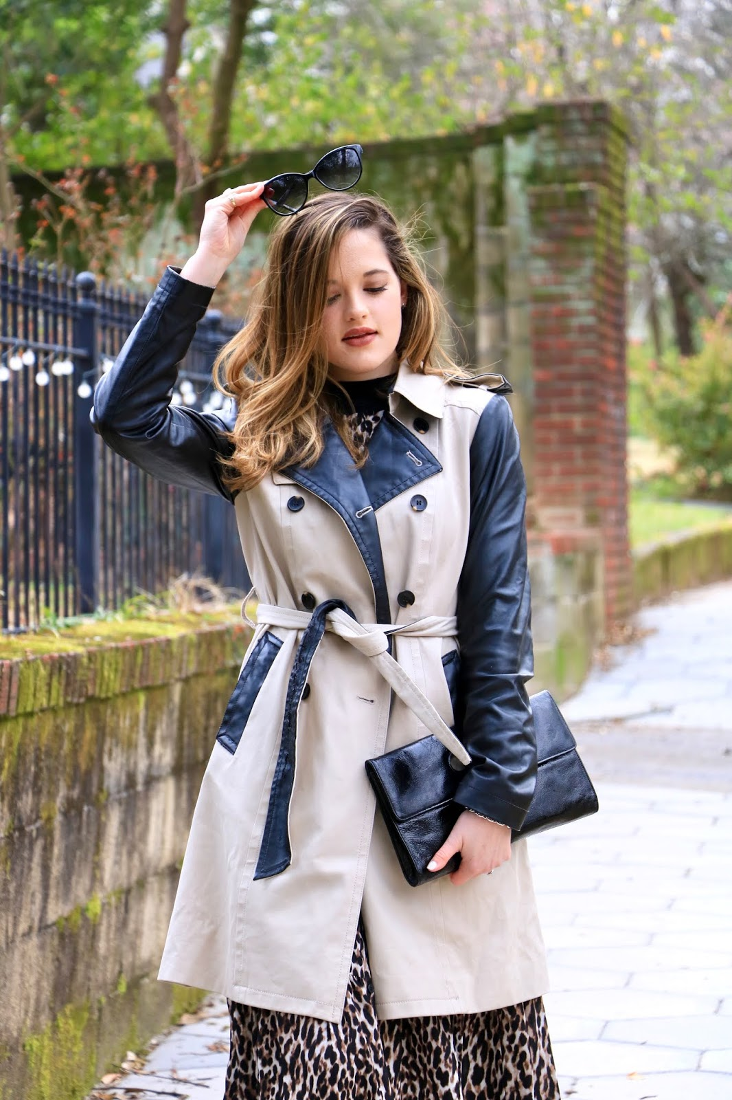 Nyc fashion blogger Kathleen Harper wearing an Ann Taylor trench coat with leather sleeves.