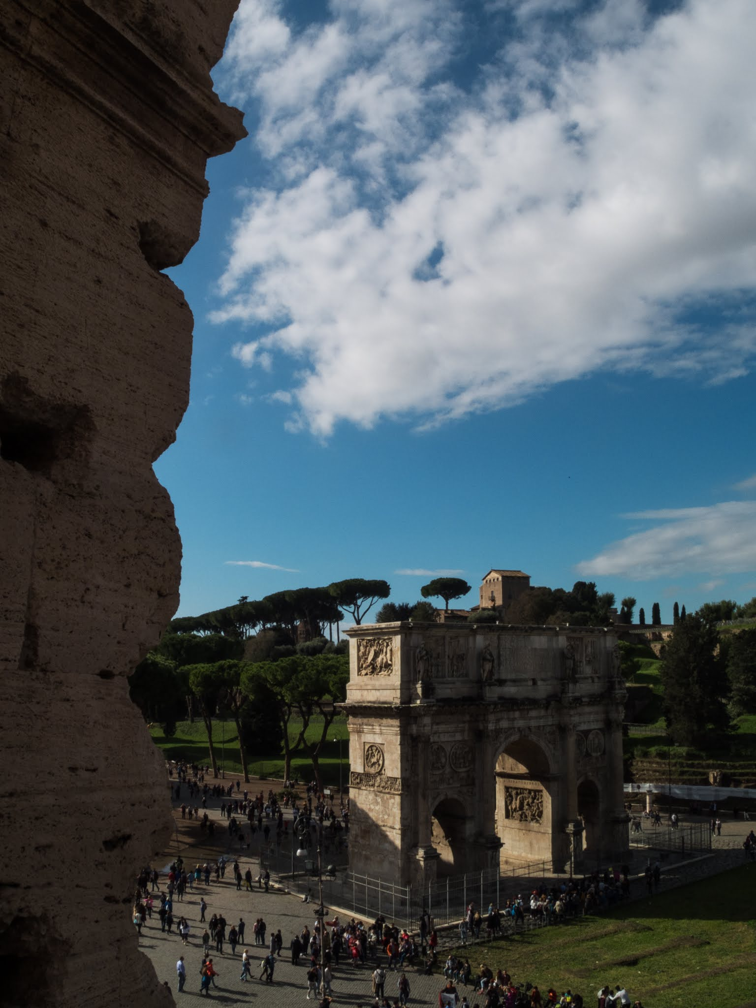 View of the Arch of Constantine with the Colosseum wall to the left.