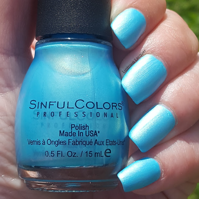 Sky blue neon nail polish with opalescent shimmer