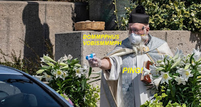 masked priest with water pistol
