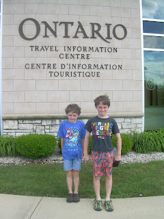The boys in front of the Ontario travel information centre.