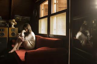 beautiful-young-teen-girl-in-deep-thoughts-sitting-near-window.jpg