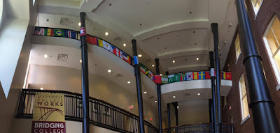 picture of Barlett Hall atrium with international flags hanging