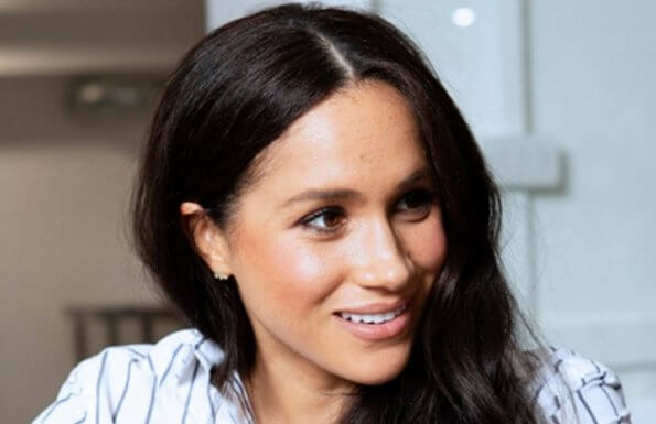 Meghan Markle wore WNU shirt, J.Crew Juliette blazer, Adina Reyter three diamond earrings, Adidas Stan Smith sneakers