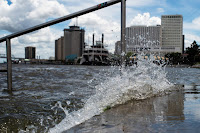 The rain-swollen Mississippi River was already flooding walkways and steps near a New Orleans levee when Barry became the second named storm of the 2019 Atlantic hurricane season on July 11. (Credit: Matthew Hatcher/SOPA Images/LightRocket via Getty Images) Click to Enlarge.