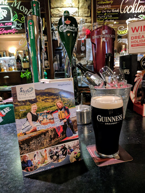 Pint of Guinness and the Sligo Food Trail brochure at Cawley's Guesthouse in Tubbercurry Sligo Ireland