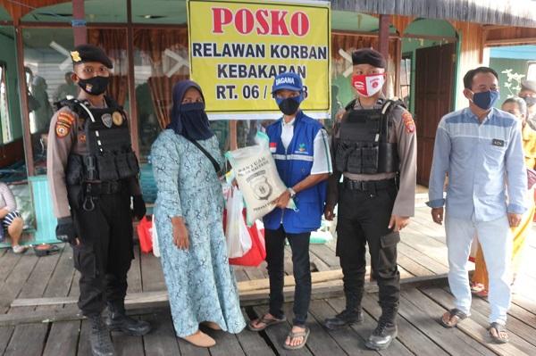Peduli Korban Kebakaran Di Flamboyan, Polda Kalteng Bagikan 50 Paket Daging Dan Sembako
