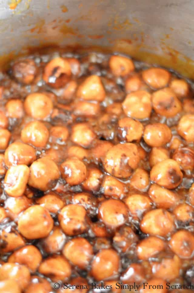 Spiced Candied Hazelnuts in thick caramel color candy mixture.