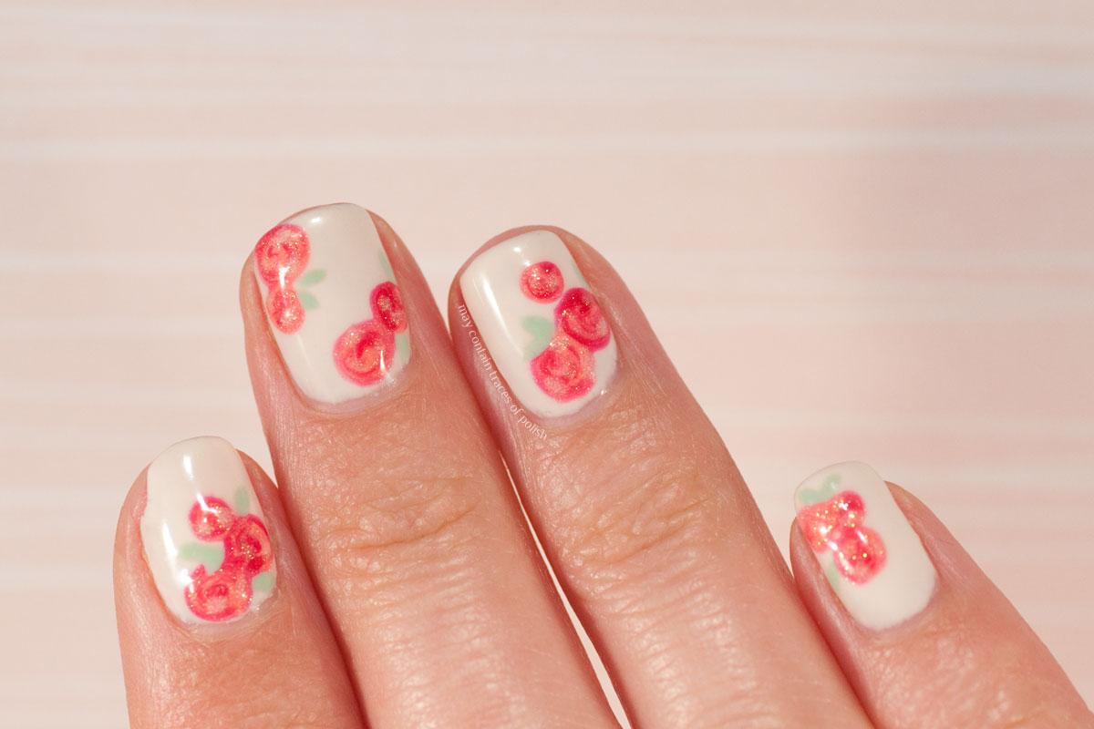 Swirly Rose Nail Art Design with Pink Gellac nail polish.