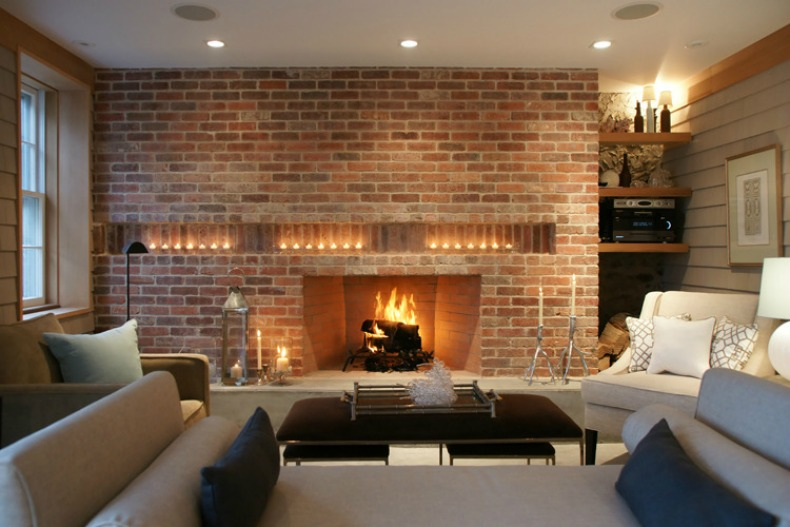 The Family Room is modern coastal and has a beautiful brick wall with fireplace to accent the room
