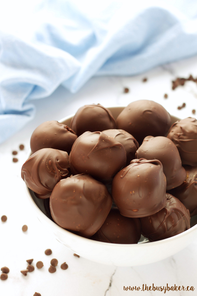 These No Bake Chocolate Dipped Cookie Dough Balls are the perfect sweet treat recipe! www.thebusybaker.ca