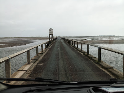 Photo of the causeway to Holy Island with the rescue tower just ahead.
