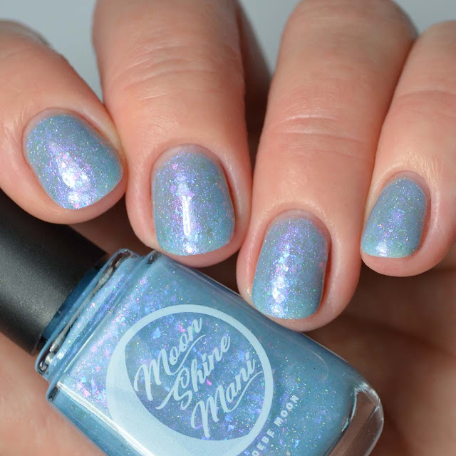 blue jelly nail polish with flakies swatch