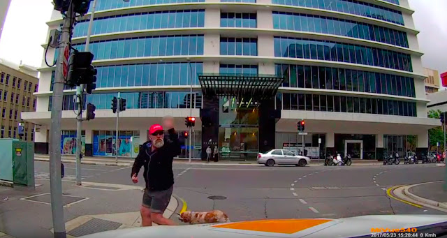 "A Screen Capture From The Video Below: An Angry Pedestrian Just Before Instant ""Reward."""