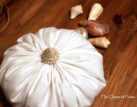white fabric pumpkin with shell