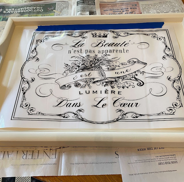 Photo of a tray with a decor transfer taped to the top of it