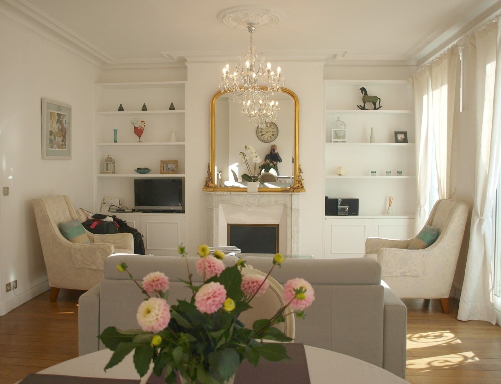 White living room in our Paris apartment - by Hello Lovely Studio