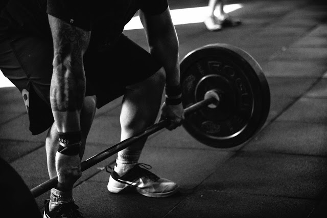 Man about to deadlift, bodybuilding, strength training