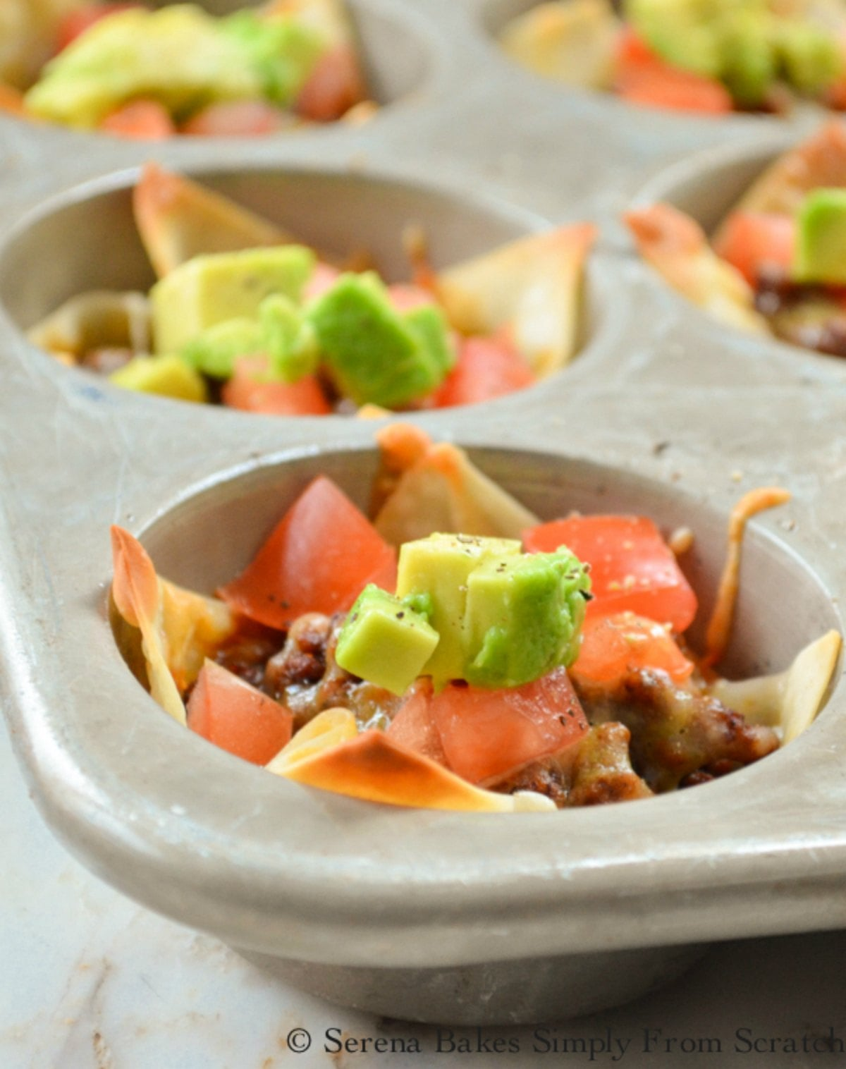 Wonton Taco Cups filled with homemade ground beef enchilada filling are a favorite easy finger food appetizer or dinner recipe from Serena Bakes Simply From Scratch.