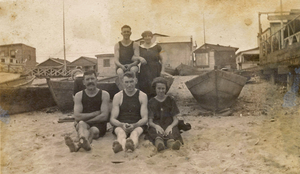 At the beach, sometime in the 1920's. Members of the Karvoius family: Alice, Constatntine, Estelle;  two unidentified men on right in front and back rows.
