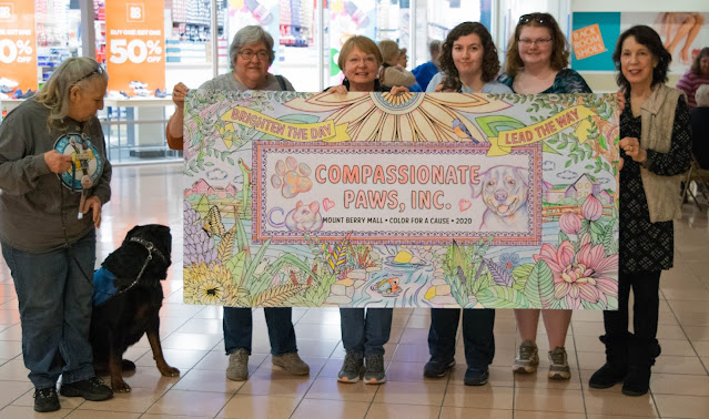 Compassionate Paws with the winner banner for color for a cause