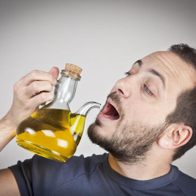 فوائد زيت الزيتون علي الريق للجسم