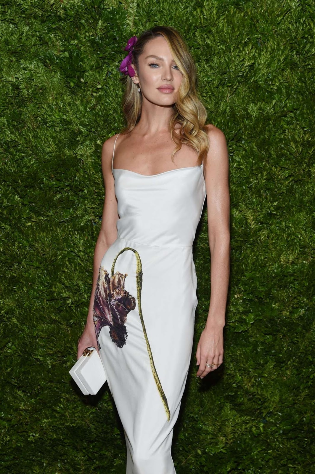 Candice Swanepoel is radiant in floral gown as she attends the CFDA/Vogue Fashion Fund Awards in New York