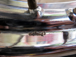 Close-up of rust spot on wheel rim.