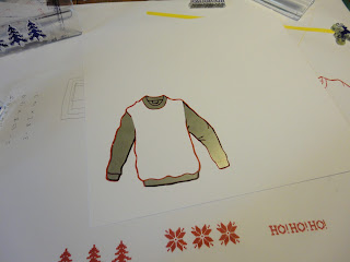 Red and white stamped knitted jumper outline