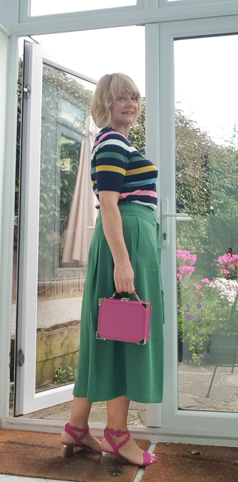 A striped knitted tee and green midi skirt from Boden accessorized with pink and worn by mid life blogger Gail Hanlon from Is This Mutton dot com