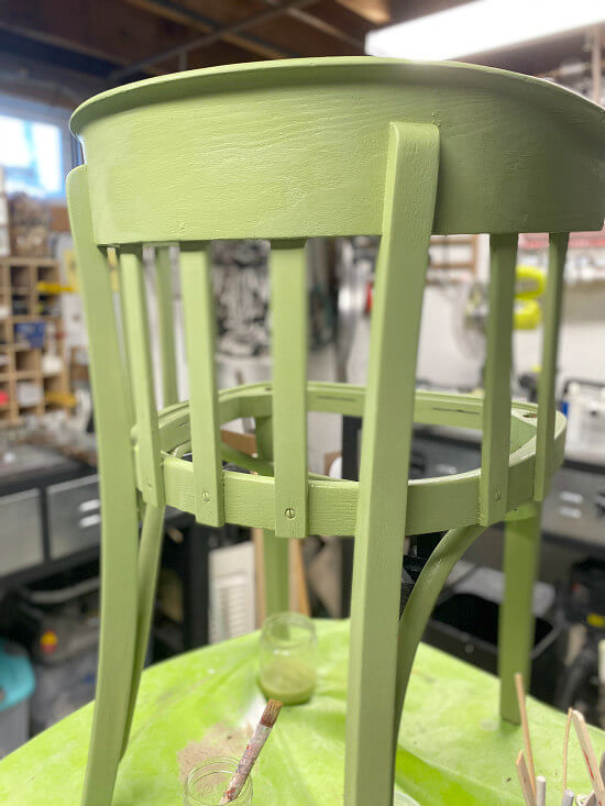 painted green chair up on a table