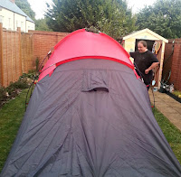 Man with tent in garden