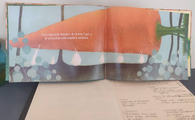 one interior spread of La Carota Gigante showing rabbits carrying a giant carrot, with handwritten notes below book.