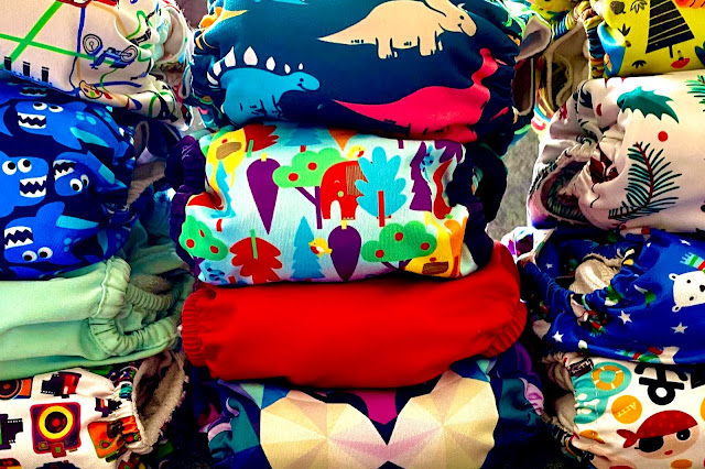 Part of a cloth nappy stash in lots of fun prints including Christmas, Sharks, geometric lion, Babipur elephant and pirate