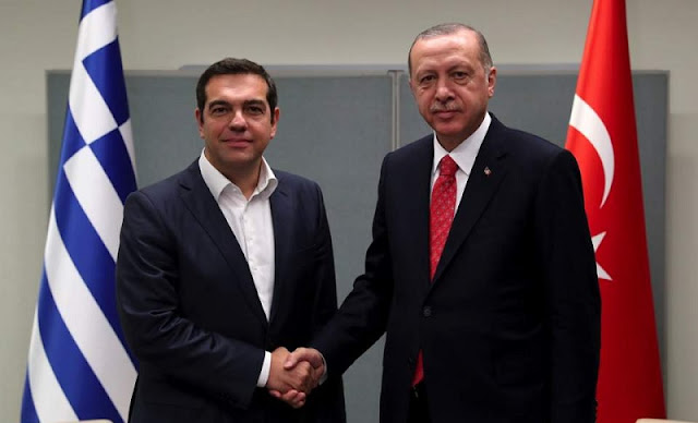 Tsipras and Erdogan shaking hands