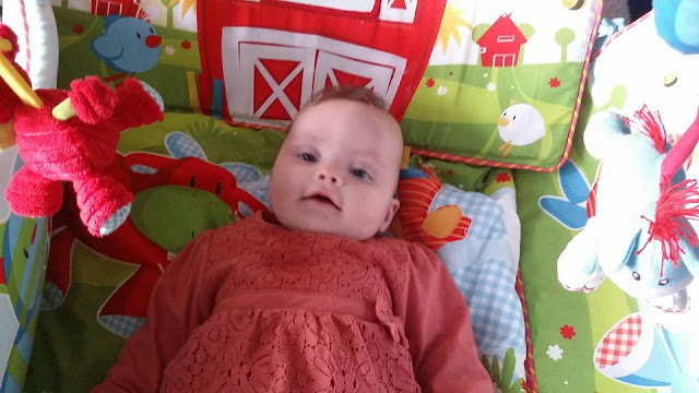 The youngest on her play mat