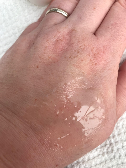Shaving oil on the back of a hand