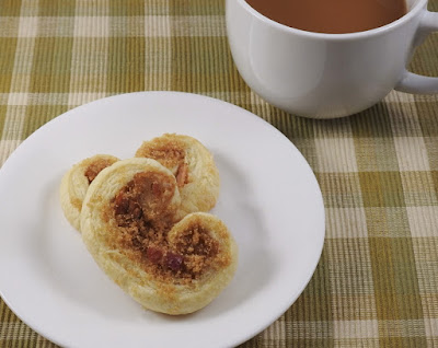 pastry on white plate with cup of coffee