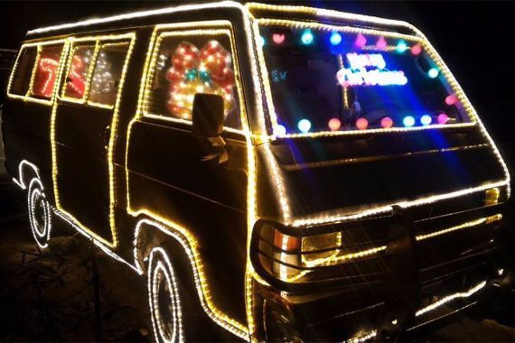 Van covered in christmas lights