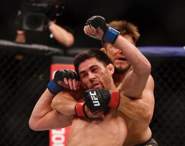 Henry Cejudo lifys Dominick Cruz UFC 249
