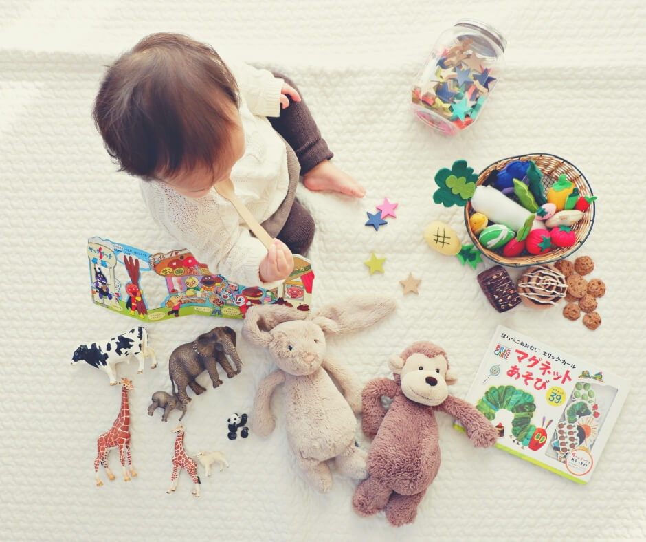 10 Things You'll Learn From Being A Parent | Be prepared for lots and lots of toys, like this baby surrounded by toys.