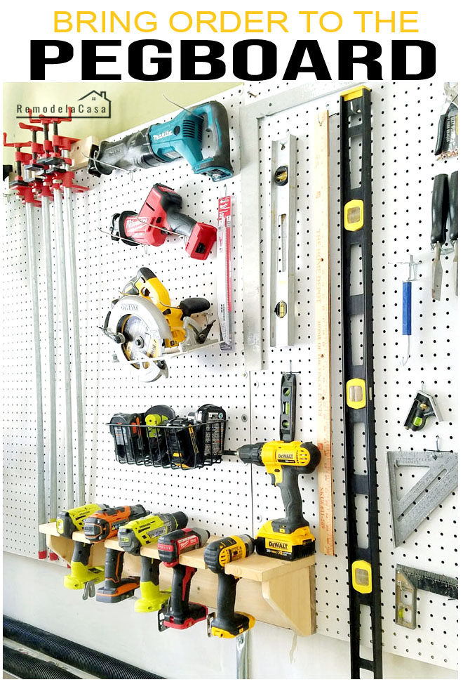 drills, clamps levels, tools on the pegboard