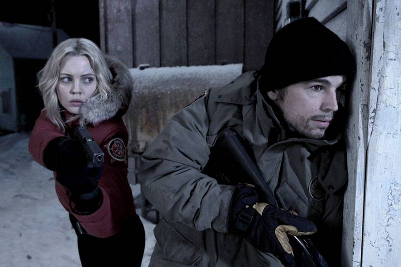 Male and Female police offiicers sneaking around a corner to try and get past vampires