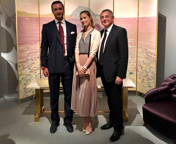 Beatrice Borromeo Casiraghi wore a multi beige pleated midi skirt by Givenchy. Meghan Markle same Givenchy skirt