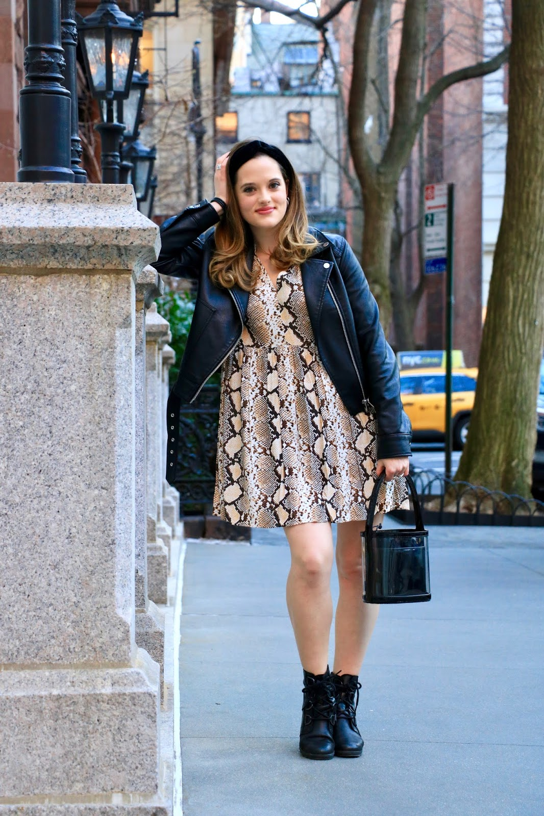 Nyc fashion blogger Kathleen Harper wearing an Anthropologie snakeskin dress with a black leather jacket.