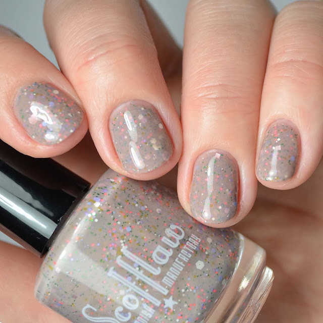 nude nail polish with 60's inspired glitter mix swatch