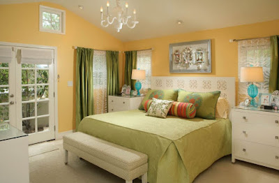 Bright yellow bedroom walls color with green curtains duvet and pillows