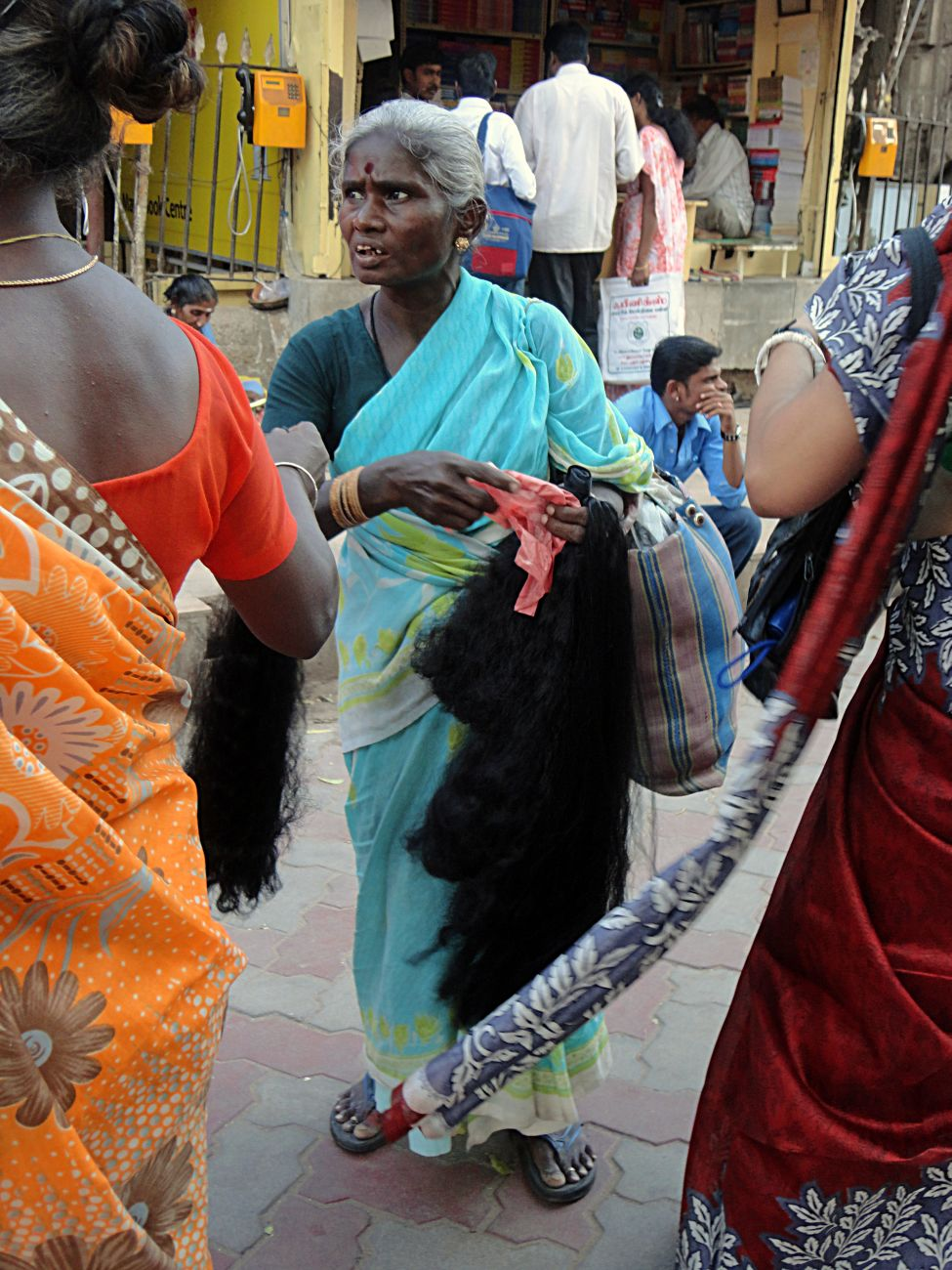 Stock Pictures Woman Selling Hair Outside Temple In India