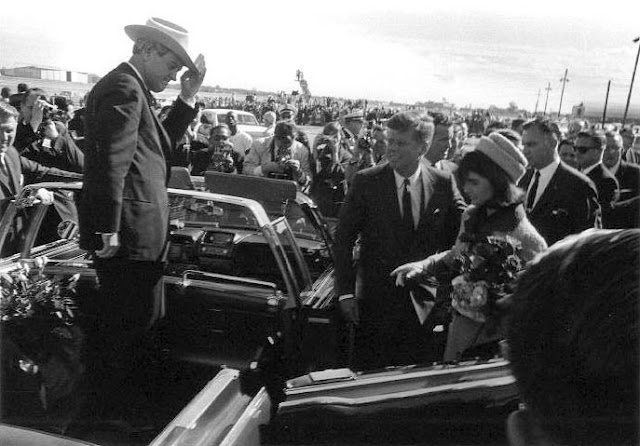 Connally stands in the Limousine allowing JFK and Jaqueline to enter.